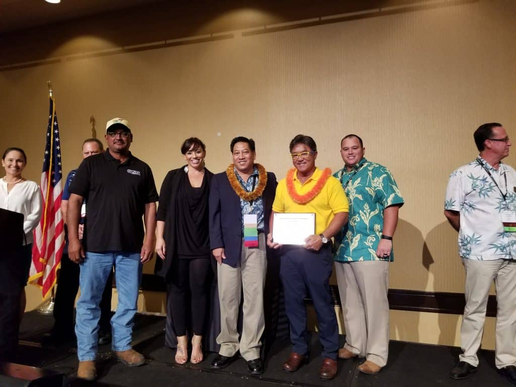 Guy Akasaki and CRW crew receiving safety award.